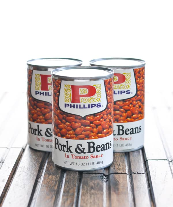 Three cans of pork and beans in tomato sauce