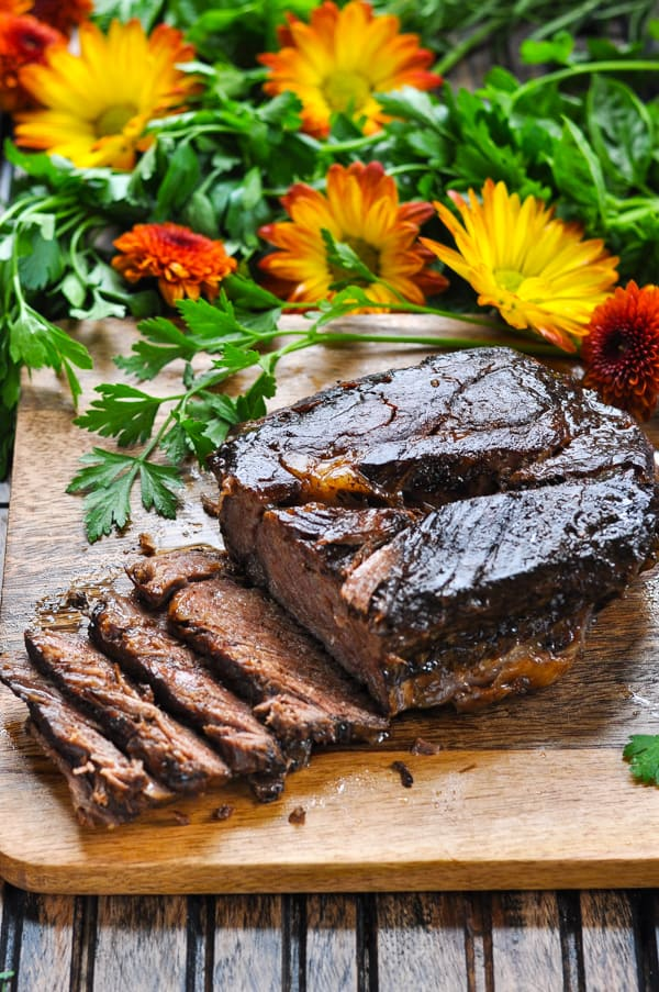 Balsamic Slow Cooker Roast Beef on a cutting board