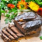 Easy Slow Cooker Roast Beef on a cutting board with text overlay