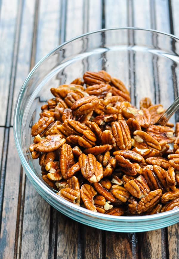 Pecan halves in glass mixing bowl