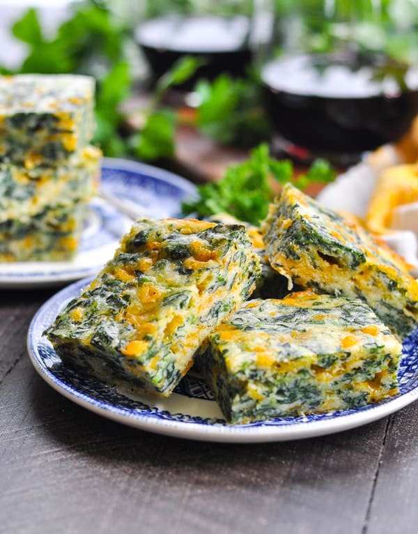 Plate of easy appetizers called cheesy spinach squares