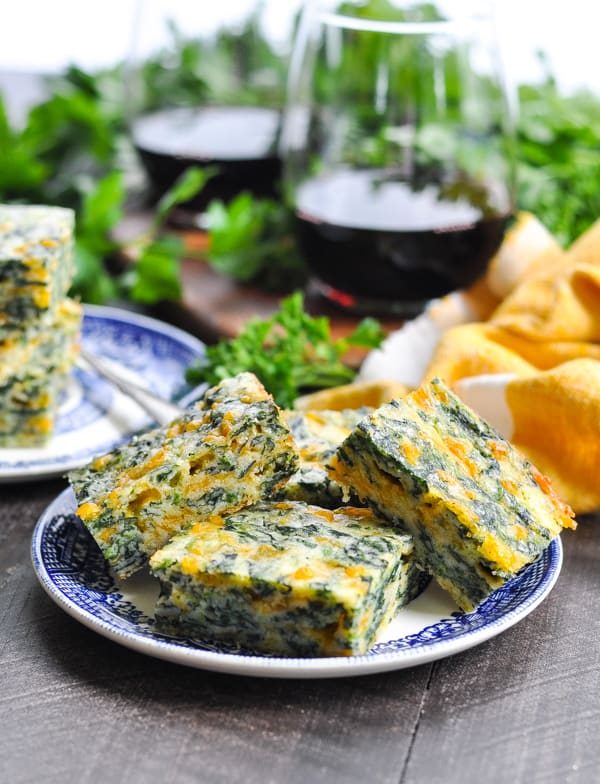 Plate of easy make ahead appetizers called spinach squares