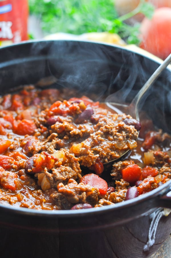 Close up image of ladle with chili con carne