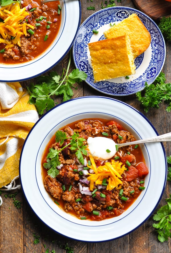 Overhead image of bowl of Chili Con Carne with a side of cornbread