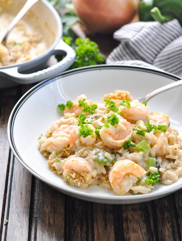 Dump and Bake Shrimp and Rice Casserole in a bowl with fork