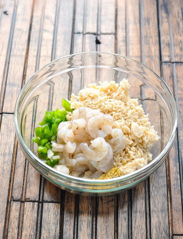 Shrimp and rice ingredients in glass bowl