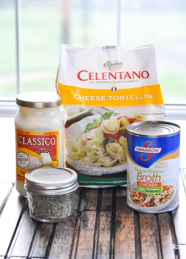 Cheese tortellini and other ingredients for tortellini alfredo with chicken