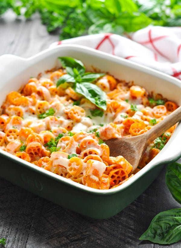 Vegetarian pasta casserole in baking dish garnished with basil