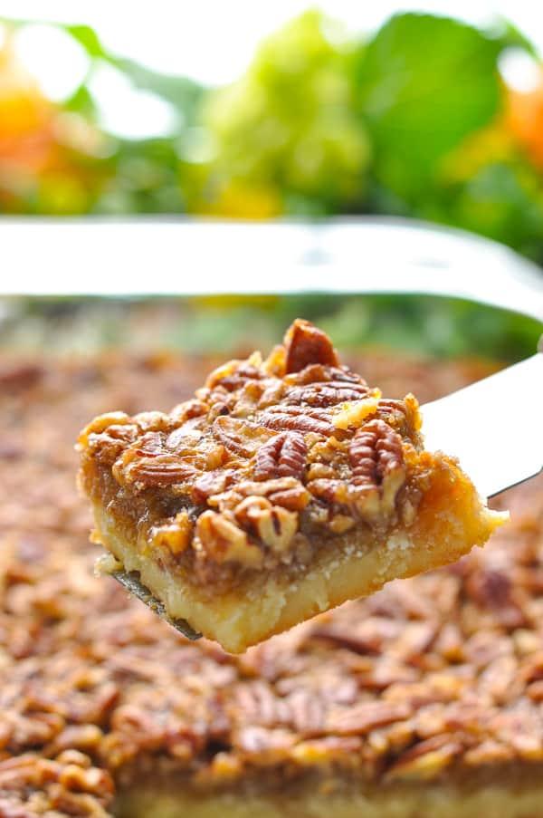 Easy Pecan Pie Bars on a spatula