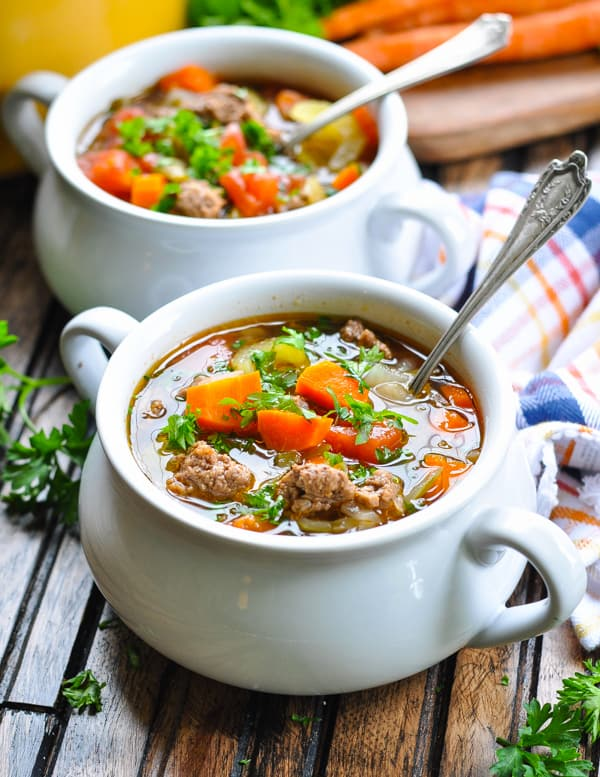 Hamburger soup in a bowl garnished with fresh parsley