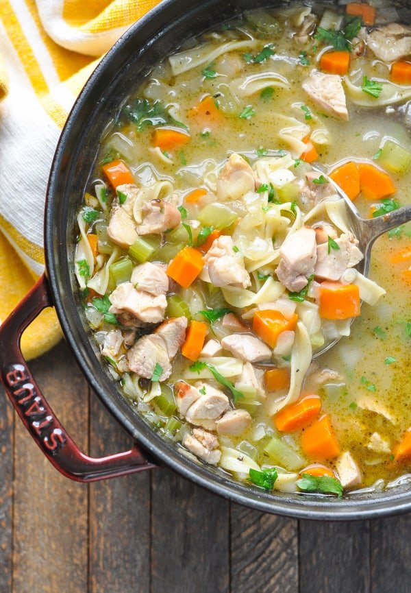 Overhead close image of turkey noodle soup in pot
