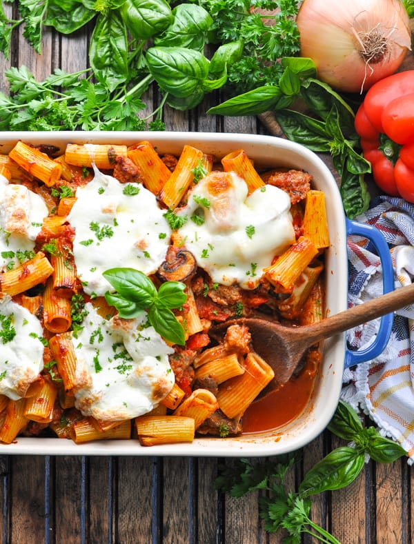 Overhead image of Italian Sausage Pasta Bake garnished with fresh basil and parsley
