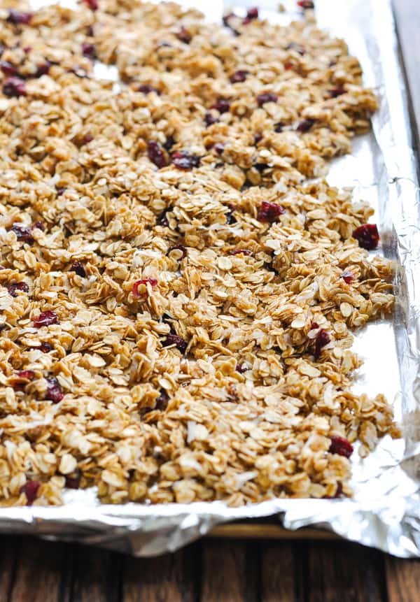 Granola spread on baking sheet before oven