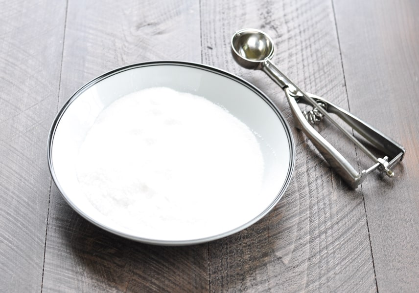 Sugar in a shallow bowl for coating molasses cookies