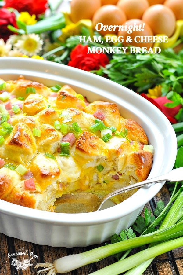 Overnight Ham Egg and Cheese Monkey Bread Breakfast Casserole in a white baking dish with text overlay