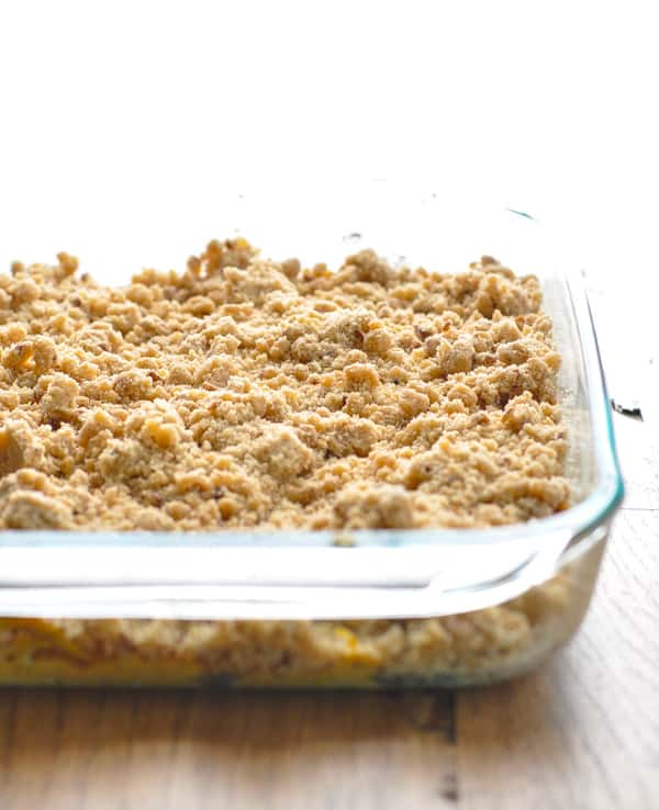 Easy pumpkin coffee cake in glass baking dish before oven