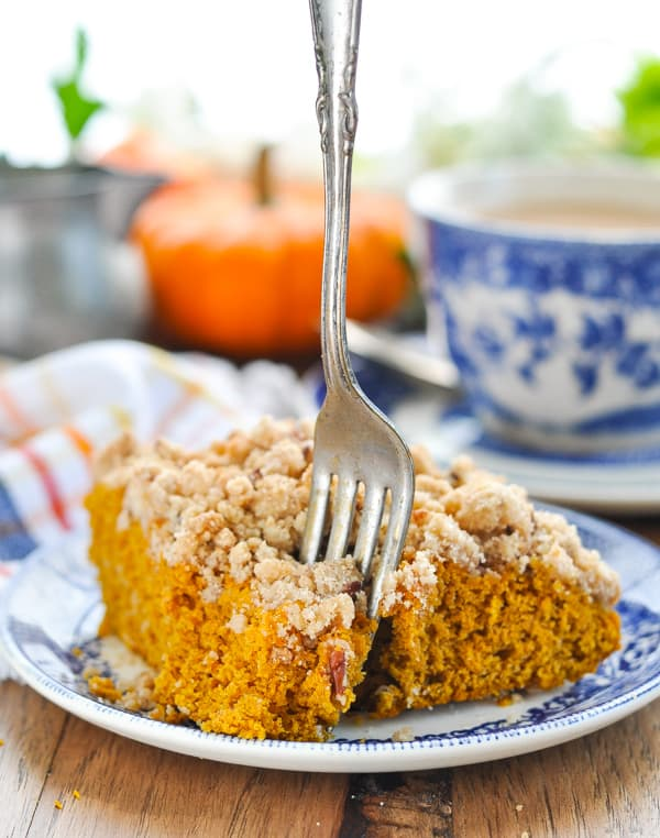 Fork in a slice of spiced pumpkin coffee cake on a plate