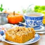 Spiced pumpkin coffee cake on a plate with text overlay