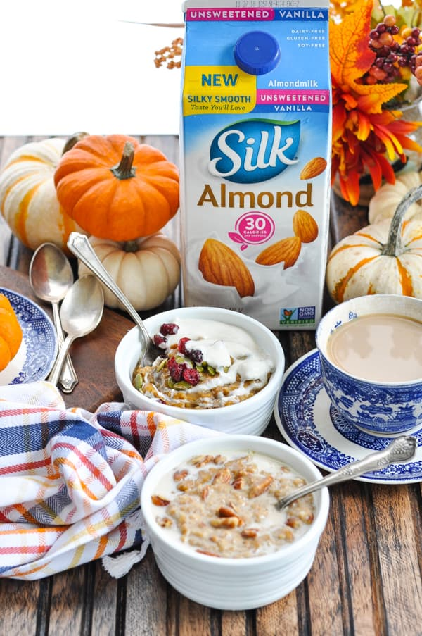Pumpkin Spice Slow Cooker Oatmeal with vanilla almond milk in the background