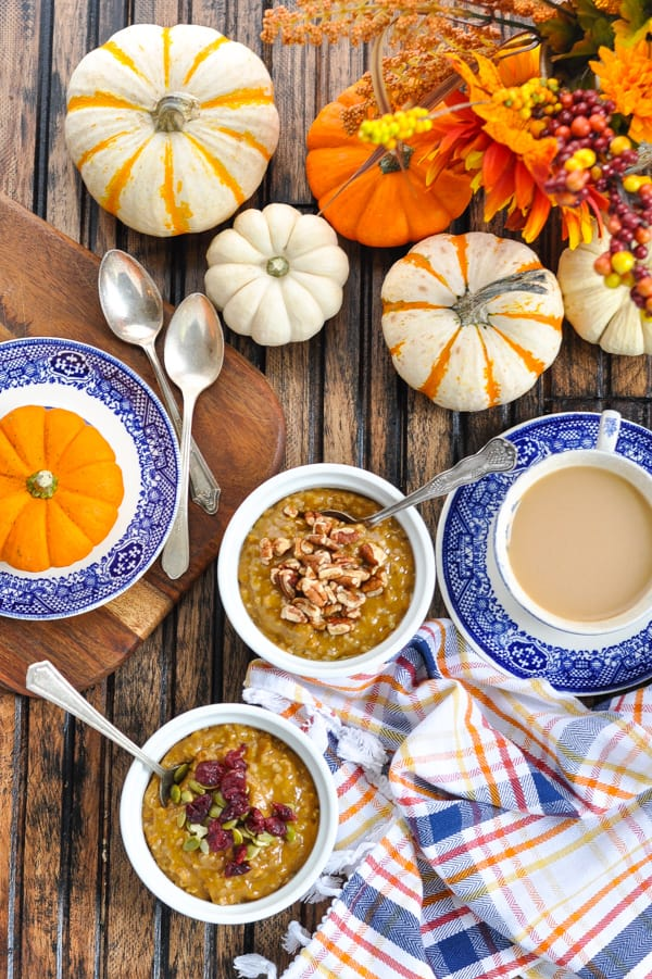 Overhead image of fall breakfast table with pumpkin spice slow cooker oatmeal