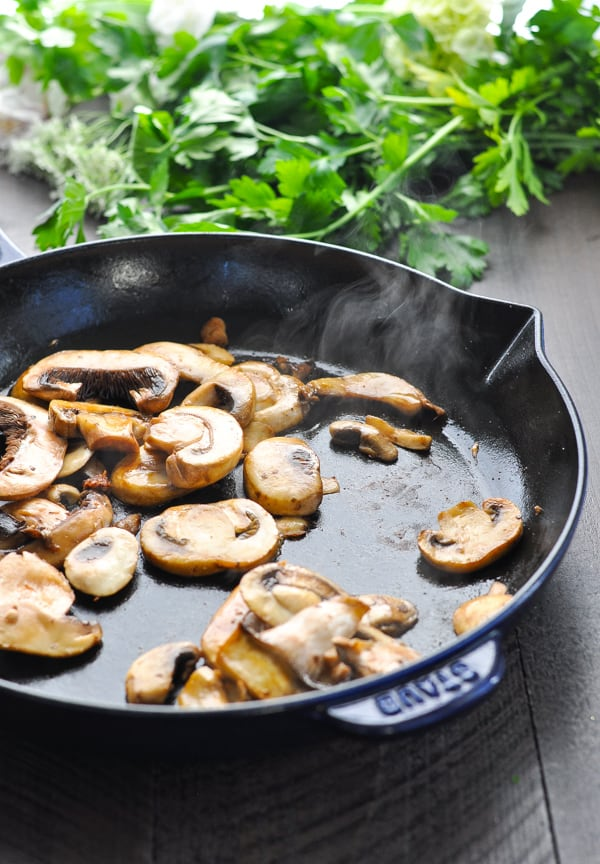 Cooked mushrooms in cast iron skillet