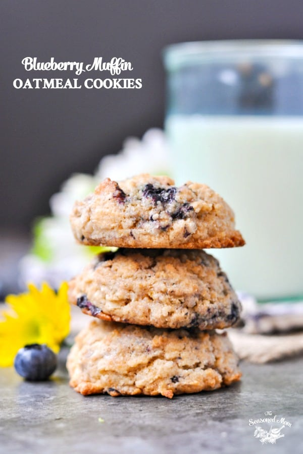 A close up of three blueberry muffin easy oatmeal cookies stacked on top of each other