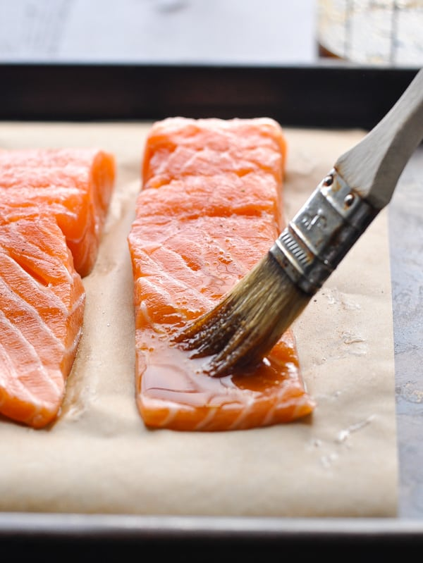 Basting salmon fillets with glaze