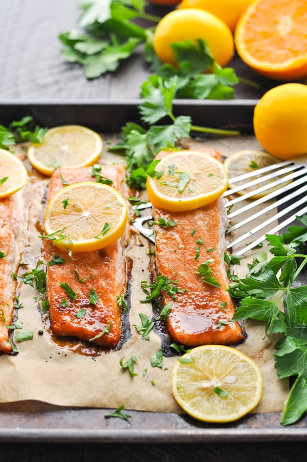 Glazed oven baked salmon fillets on baking sheet