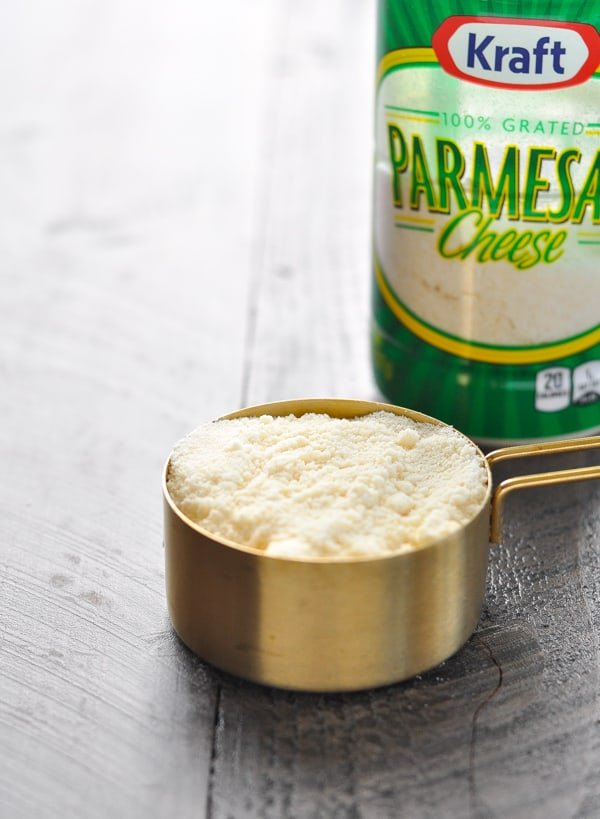 Grated parmesan cheese in measuring cup