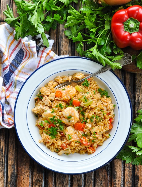 Overhead image of a bowl of One Pot Turkey Jambalaya with shrimp garnished with parsley