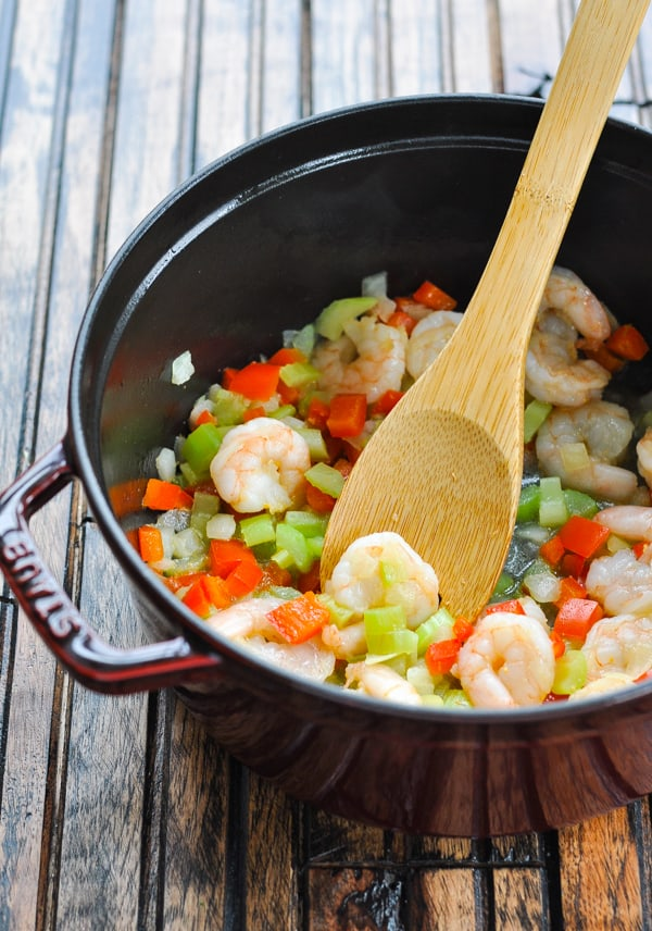 Cooked shrimp and vegetables in Dutch oven