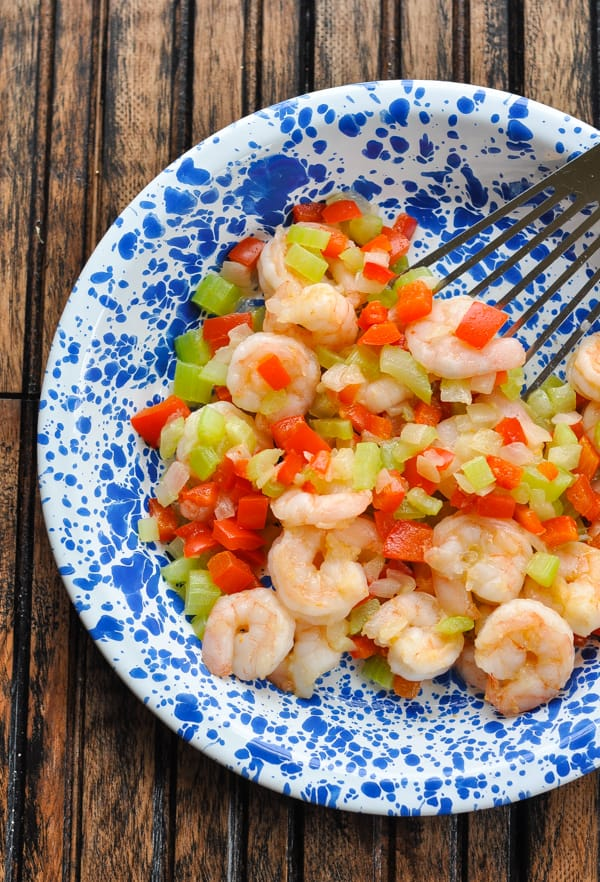 Cooked shrimp and vegetables for jambalaya in a plate