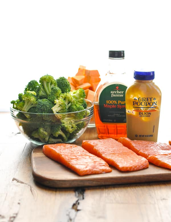 5 ingredients for sheet pan dinner with salmon sweet potatoes and broccoli