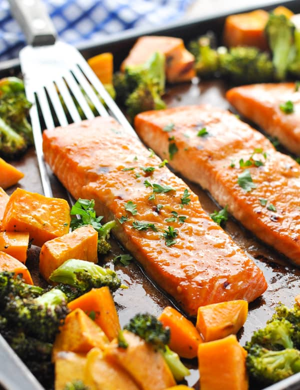 Close up image of maple glazed salmon fillet on a spatula on a sheet pan