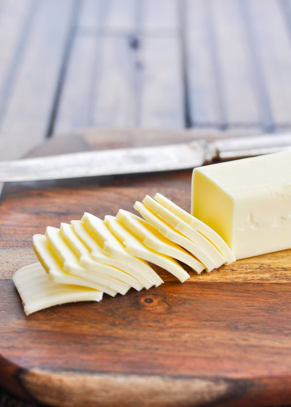 Thinly sliced stick of butter on a cutting board