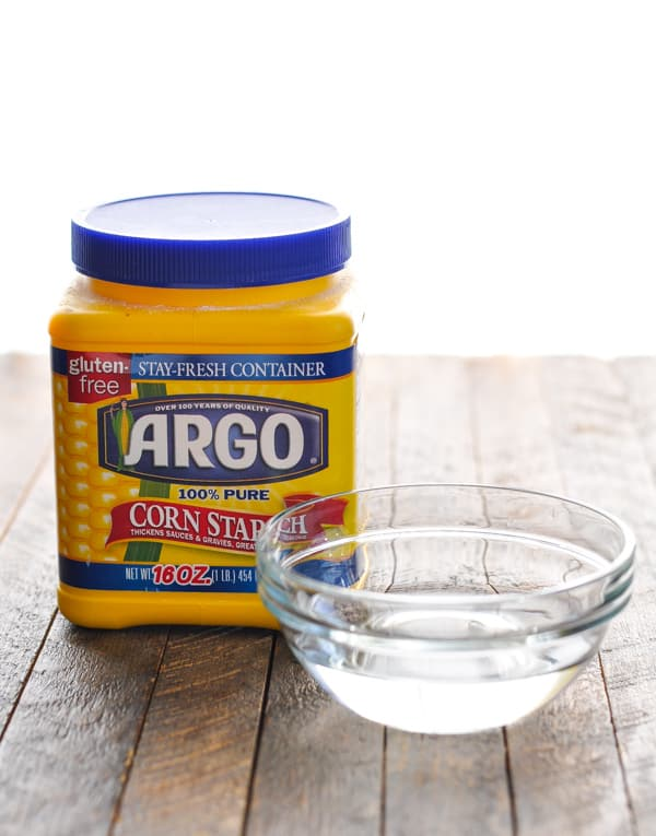 Cornstarch container and small bowl of water