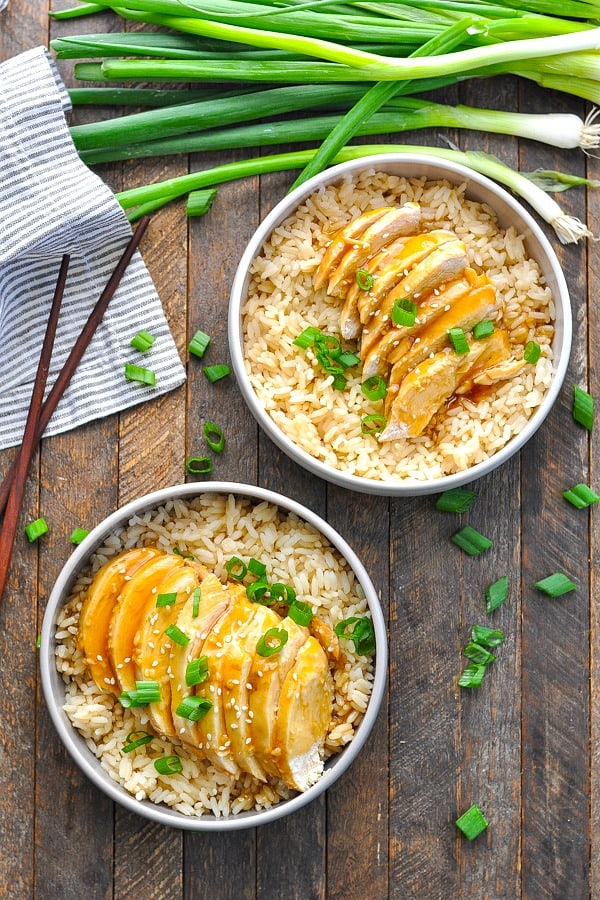 Long overhead shot of two bowls of healthy Chicken Teriyaki recipe.