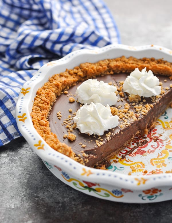Chocolate Pudding Pie with a graham cracker crust and whipped cream on top