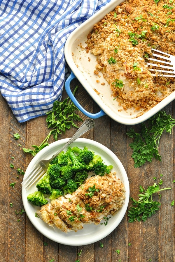 Chicken Stuffing Bake in dish and on plate with blue and white cloth napkin