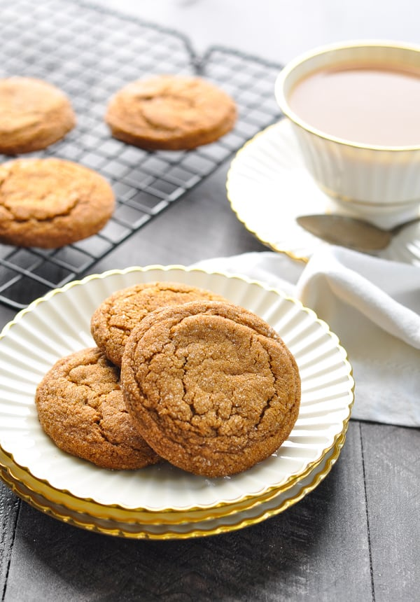 Old Fashioned Molasses Cookies on a plate with coffee in the background