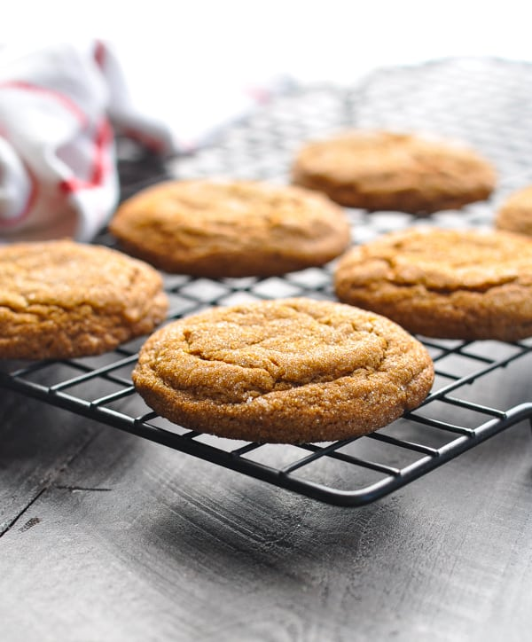 Old fashioned chewy and soft molasses cookies cooling on wire rack