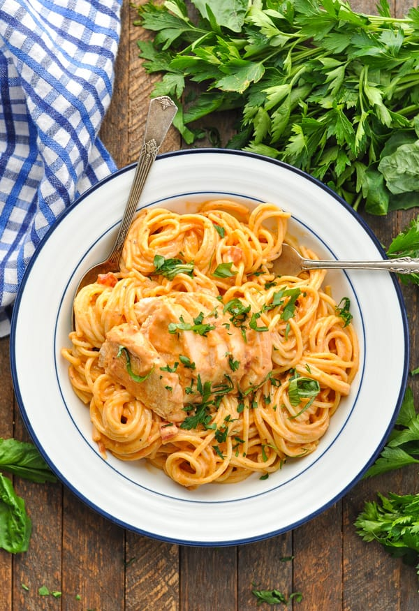 Overhead image of Crock Pot Chicken Spaghetti in a blue and white bowl