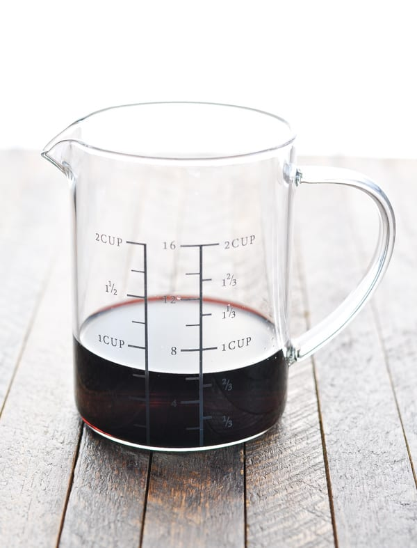 Red wine in glass measuring cup
