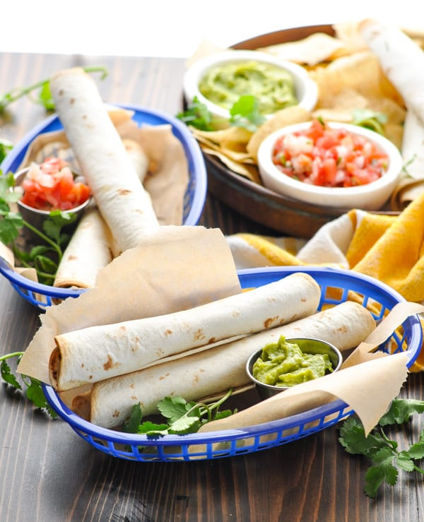 Serving baskets of beef and cheese baked taquitos