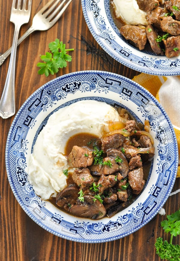Close overhead shot of beef tips with mushroom gravy in a bowl