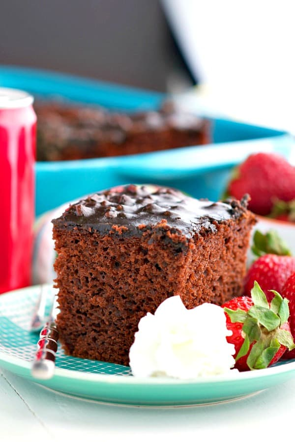 Slice of Coca Cola Cake on a teal plate