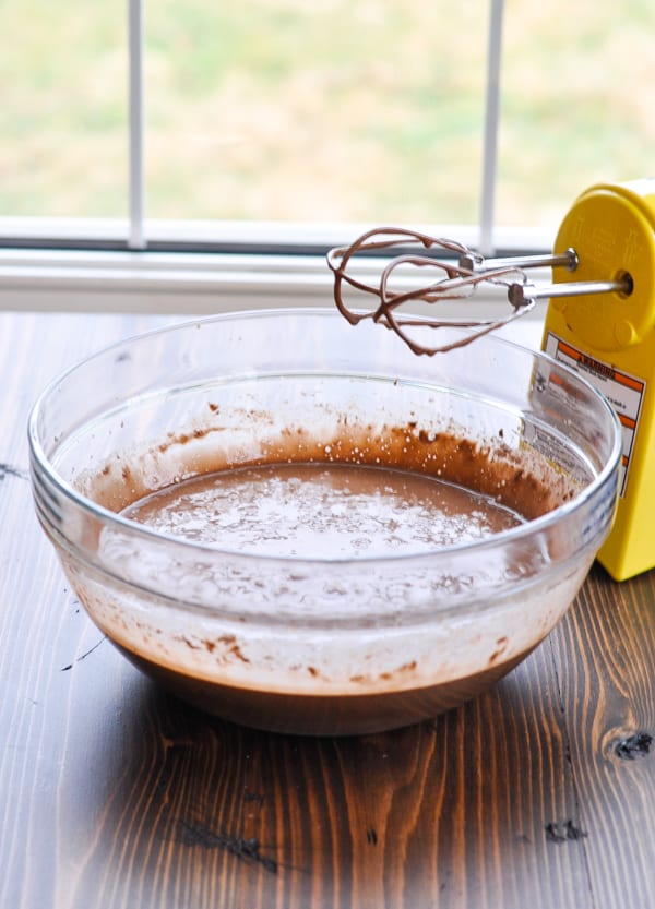 Batter with mixer for Coca Cola Cake in glass bowl