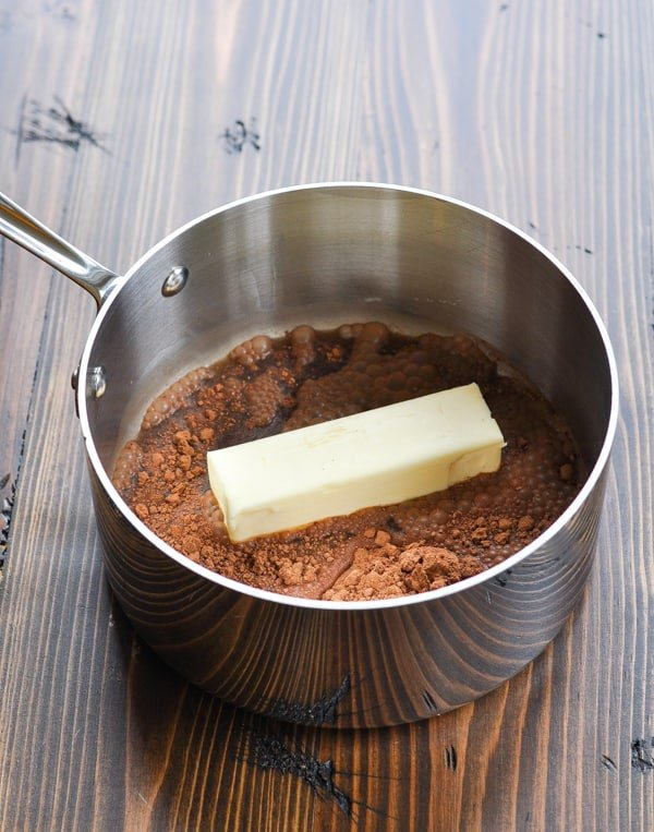 Ingredients for Coca Cola Frosting in saucepan