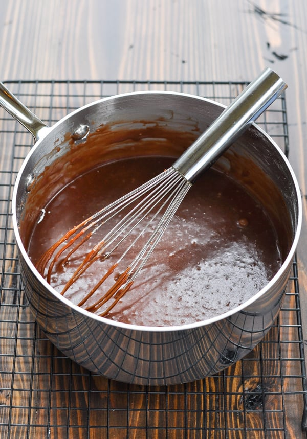 Coca Cola Frosting in saucepan with whisk