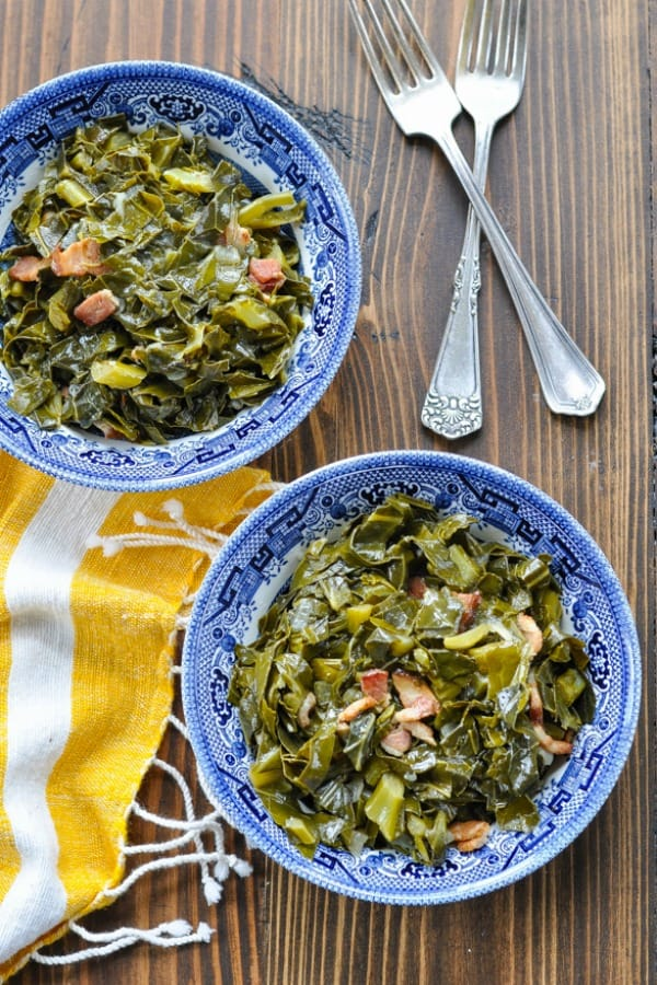 Overhead shot of two bowls of collard greens